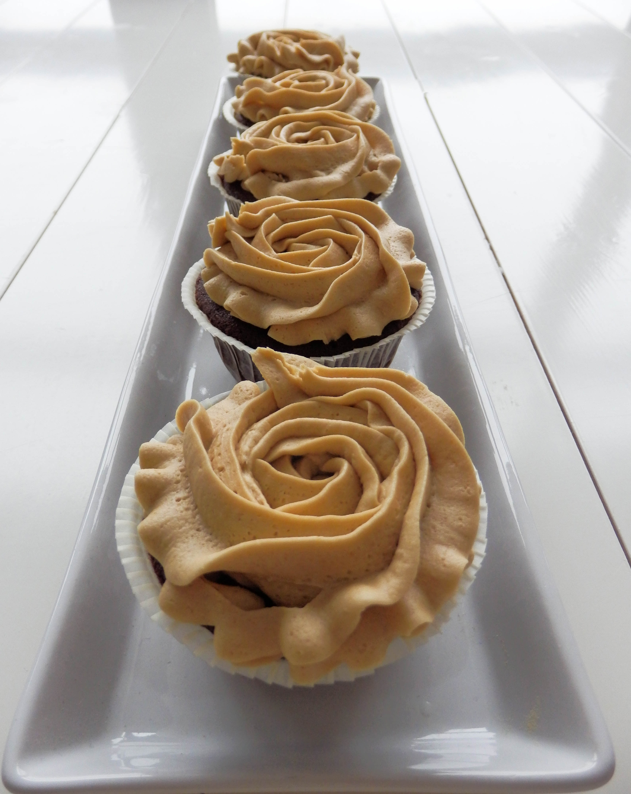 cupcakes with frosing in line