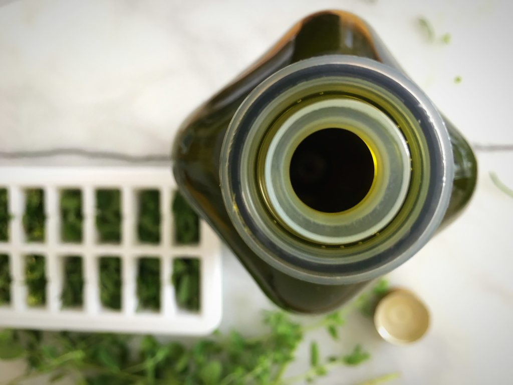 Olive Oil bottle and herbs